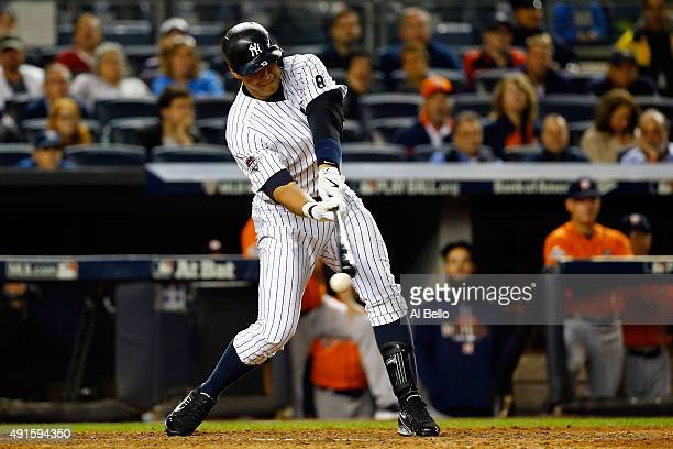 Alex Rodriguez of the New York Yankees strikes out in the ninth inning against Luke Gregerson of the Houston Astros during the American League Wild...