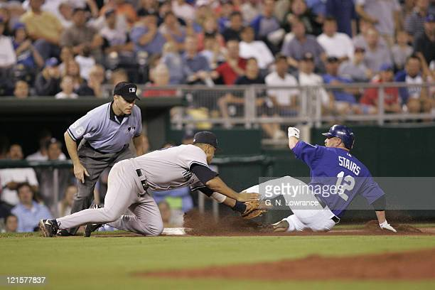 Alex Rodriguez of the New York Yankees tags out Matt Stairs during a game against the Kansas City Royals at Kauffman Stadium in Kansas City Mo The...
