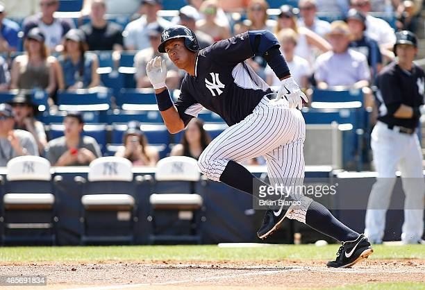 Alex Rodriguez of the New York Yankees takes off for first base after hitting an RBI single off of pitcher Nathan Karns of the Tampa Bay Rays during...