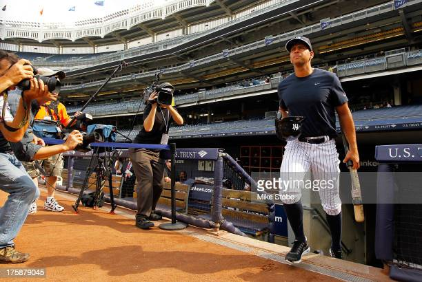 Alex Rodriguez of the New York Yankees takes the field for batting practice prior to the game against the Detroit Tigers at Yankee Stadium on August...