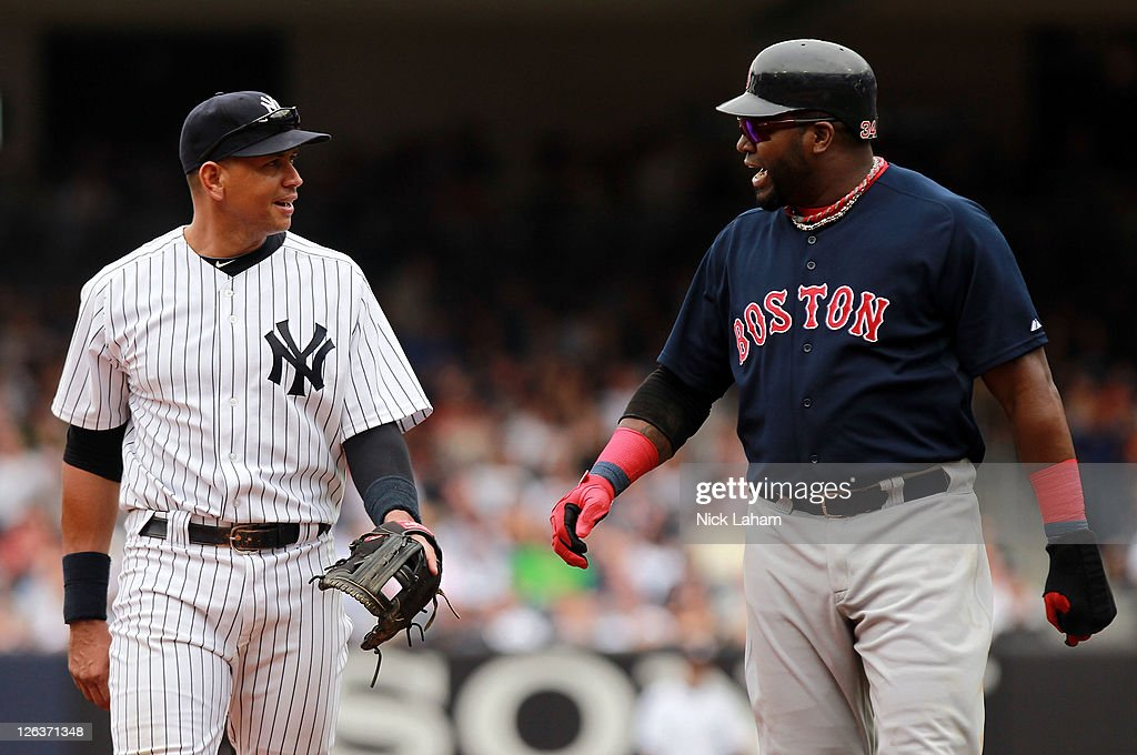 Alex Rodriguez #13 of the New York Yankees talks to David Ortiz #34 of the Boston Red Sox on September 25, 2011 at Yankee Stadium in the Bronx borough of New York City.