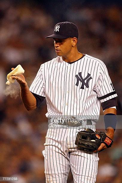 Alex Rodriguez of the New York Yankees uses the rosin bag against the Cleveland Indians during Game Four of the American League Division Series at...