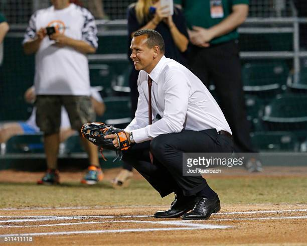 Alex Rodriguez of the New York Yankees waits behind home plate for the first pitch from Julio Frenk President of the University of Miami prior to the...