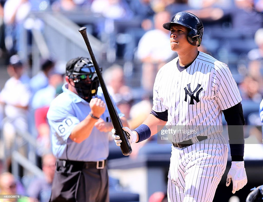 Alex Rodriguez #13 of the New York Yankees walks back to the dugout after he struck out in the sixth inning against the Toronto Blue Jays on August 9, 2015 at Yankee Stadium in the Bronx borough of New York City.