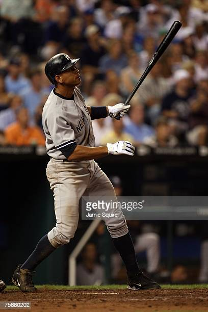 Alex Rodriguez of the New York Yankees watches as home run of his career sails over the wall during the 8th inning of the game against of the Kansas...