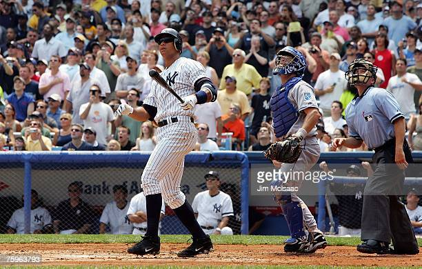 Alex Rodriguez of the New York Yankees watches the ball stay fair along with home plate umpire Jerry Meals and catcher Jason LaRue of the Kansas City...