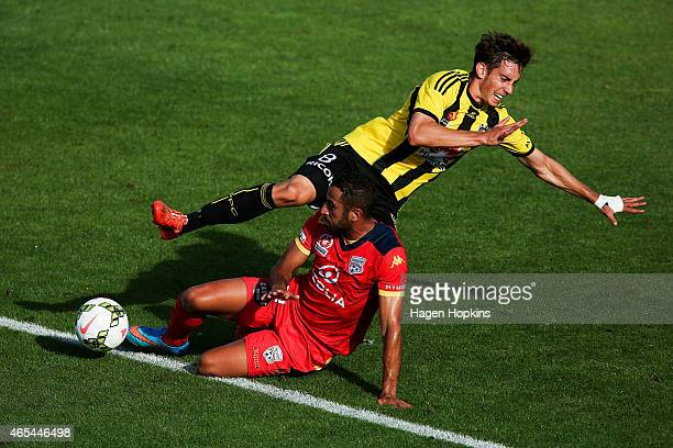 Alex Rodriguez of the Phoenix and Tarek Elrich of Adelaide United collide in a challenge during the round 20 ALeague match between the Wellington...