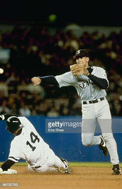 Alex Rodriguez of the Seattle Mariners throws as Luis Sojo of the New York Yankees slides into second during Game One of the 2000 ALCS at Yankee...