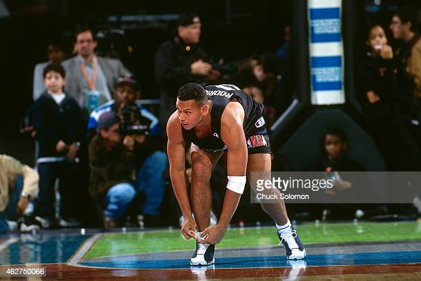 Alex Rodriguez of the Seattle Mariners ties his shoes during the Celebrity Game as part of All Star Weekend on February 7 1998 at Madison Square...
