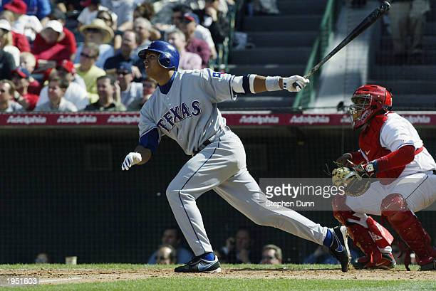Alex Rodriguez of the Texas Rangers hits his 300th career home run during the fifth inning of the game against the Anaheim Angels at Edison Field on...