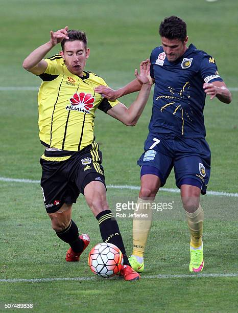 Alex Rodriguez of the Wellington Phoenix and Fabio Ferreira of the Central Coast Mariners compete for the ball during the round 17 ALeague match...