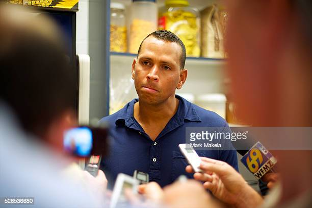 Alex Rodriguez responds to media questions in the clubhouse after ignoring fans clamoring for his autograph following a game on his rehab assignment...