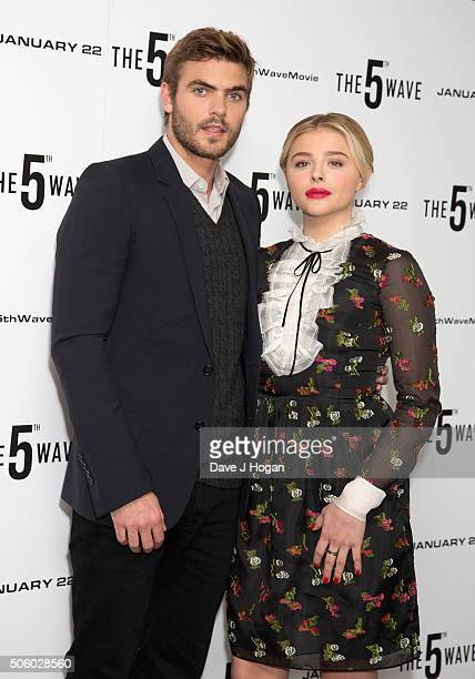 Alex Roe and Chloe Grace Moretz attends a photo call for 'The 5th Wave' at The Soho Hotel on January 21 2016 in London England