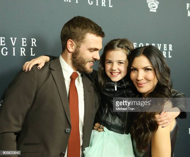 Alex Roe with Bethany Ashton Wolf and Abby Ryder Fortson arrive to the Los Angeles premiere of Roadside Attractions' 'Forever My Girl' held at The...