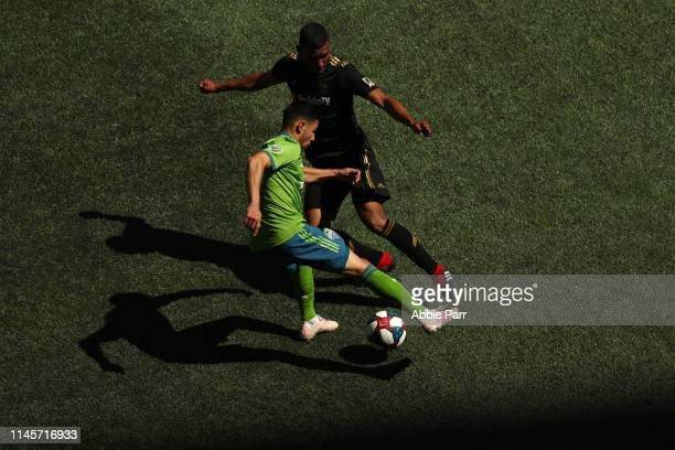 Alex Roldan of Seattle Sounders dribbles against Eddie Segura of Los Angeles FC in the second half during their game at CenturyLink Field on April 28...