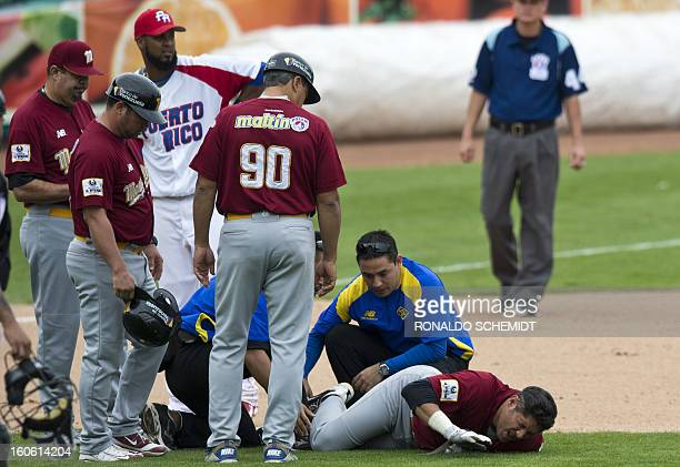 Alex Romero of Magallanes of Venezuela grimaces after getting injured during a run between second and third base in a game against Criollos de Cagua...