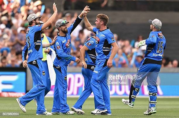 Alex Ross of the Adelaide Strikers celebrates with Hamish Kingston of the Adelaide Strikers after taking a catch to dismiss Michael Lumb of the...