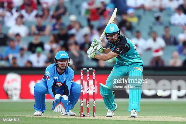 Alex Ross of the Brisbane Heat bats in front of Ben Dunk of the Adelaide Strikers during the Big Bash League match between the Adelaide Strikers and...