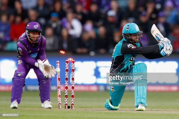 Alex Ross of the Brisbane Heat is bowled by Cameron Boyce of the Hobart Hurricanes during the Big Bash League match between the Hobart Hurricanes and...