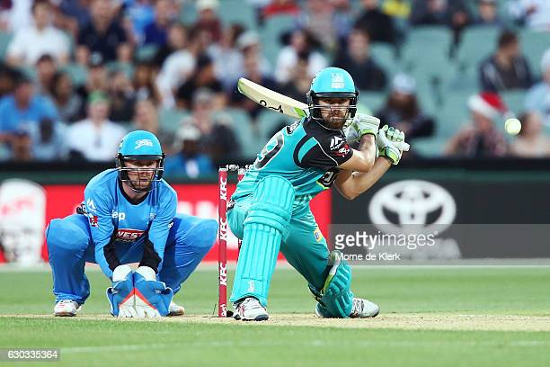 Alex Ross of the Brisbane Heat reverse sweeps in front of Ben Dunk of the Adelaide Strikers during the Big Bash League match between the Adelaide...