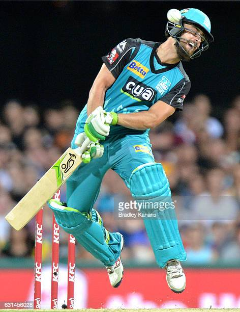 Alex Ross of the Heat attempts to move out of the way of a bouncer bowled by Mitchell Johnson of the Scorchers during the Big Bash League match...