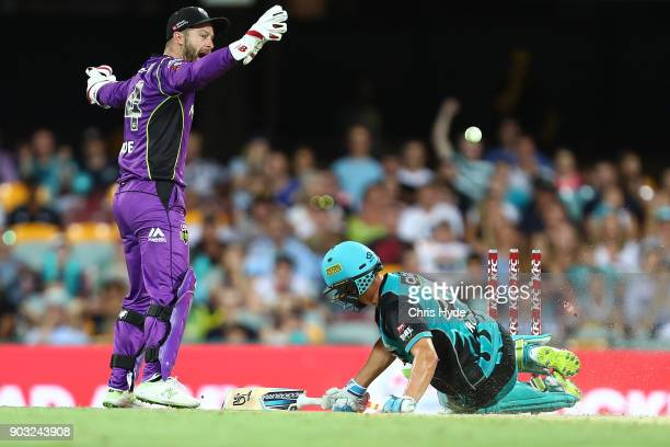 Alex Ross of the Heat is run out during the Big Bash League match between the Brisbane Heat and the Hobart Hurricanes at The Gabba on January 10 2018...