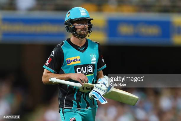 Alex Ross of the Heat leaves the field after being run out during the Big Bash League match between the Brisbane Heat and the Hobart Hurricanes at...