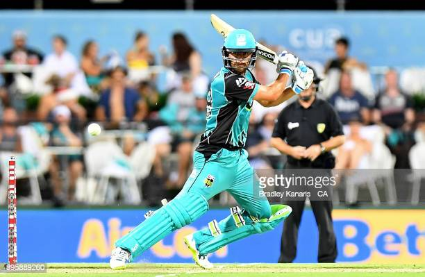 Alex Ross of the Heat plays a shot during the Big Bash League match between the Brisbane Heat and the Melbourne Stars at The Gabba on December 20...