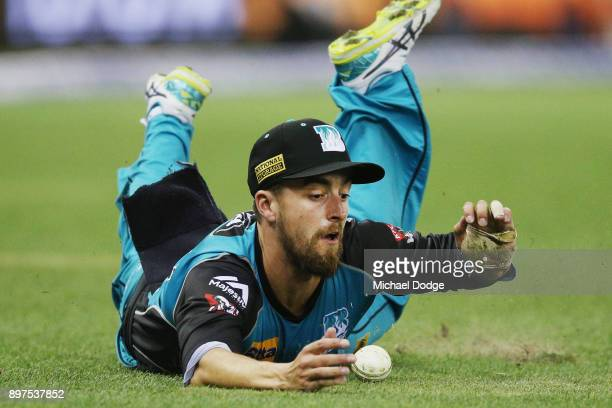 Alex Ross of the Heat saves a boundary when fielding during the Big Bash League match between the Melbourne Renegades and the Brisbane Heat at Etihad...