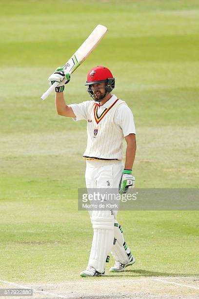 Alex Ross of the Redbacks celebrates reaching 50 runs during day 4 of the Sheffield Shield Final match between South Australia and Victoria at...