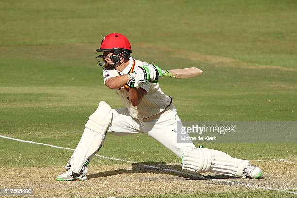 Alex Ross of the Redbacks plays a reverse sweep during day 1 of the Sheffield Shield Final match between South Australia and Victoria at Gliderol...