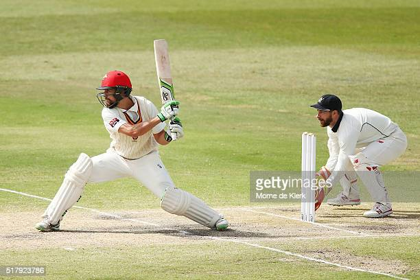 Alex Ross of the Redbacks plays a reversesweep shot in front of Matthew Wade of the VIC Bushrangers during day 4 of the Sheffield Shield Final match...
