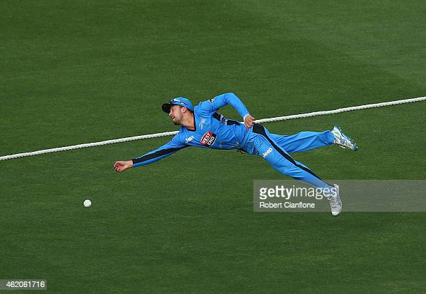 Alex Ross of the Strikers dives in an attempt to catch Michael Lumb of the Sydney Sixers during the Big Bash League Semi Final match between the...