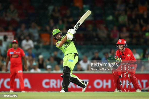 Alex Ross of the Thunder hits a six during the Big Bash League match between the Sydney Thunder and the Melbourne Renegades at Manuka Oval on January...