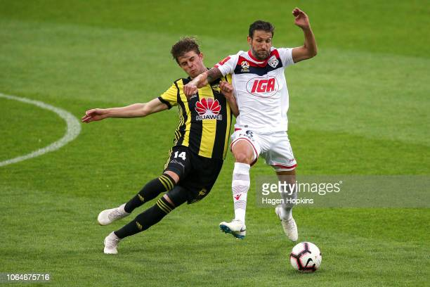 Alex Rufer of the Phoenix and Vince Lia of Adelaide United compete for the ball during the round five ALeague match between the Wellington Phoenix...