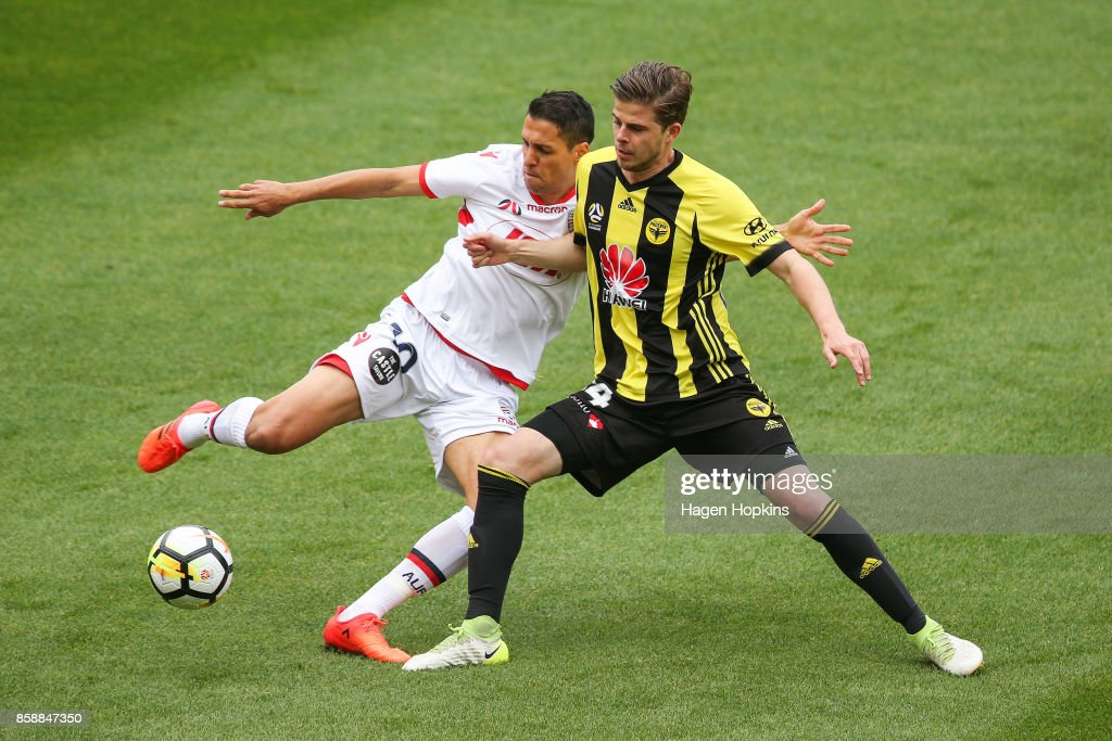 Alex Rufer of the Phoenix competes for the ball with Karim Matmour of Adelaide United during the round one A-League match between Wellington Phoenix and Adelaide United at Westpac Stadium on October 8, 2017 in Wellington, New Zealand.