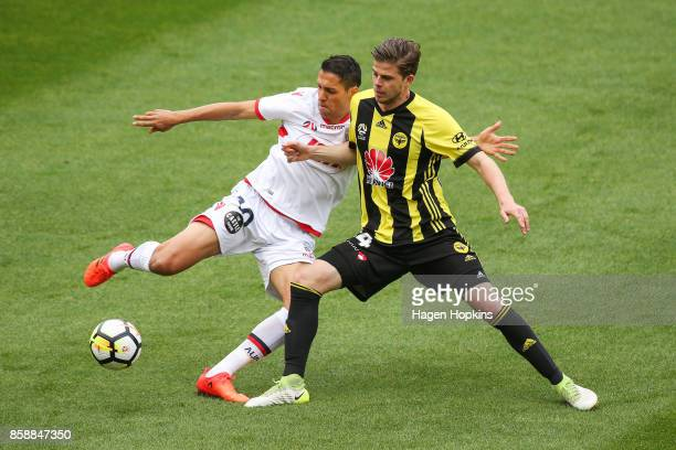 Alex Rufer of the Phoenix competes for the ball with Karim Matmour of Adelaide United during the round one ALeague match between Wellington Phoenix...