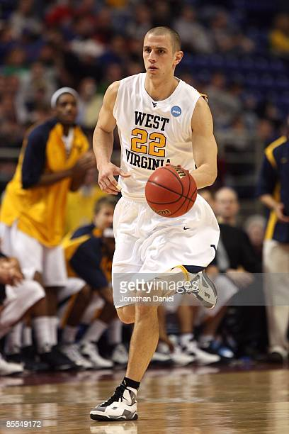 Alex Ruoff of the West Virginia Moutaineers brings the ball up court against the Dayton Flyers during the first round of the NCAA Division I Men's...