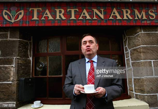 Alex Salmond leader of the SNP enjoys a cup of tea on a visit to the Tartan Arms pub on April 18 2007 in Bannockburn Scotland Mr Salmond was...