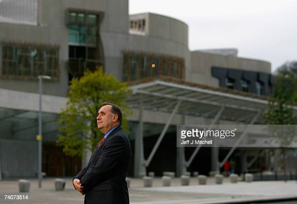 Alex Salmond leader of the SNP gives television interviews outside the Scottish Parliament building after the party won the Scottish Parliamentary...