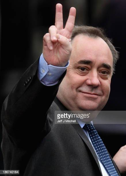 Alex Salmond Scotland's First Minister and Scottish National Party gives the victory sign as he departs after attending the opening of Barclays...