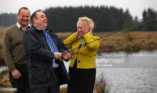 Alex Salmond SNP leader and candidate Christine Grahame visit Leadburn Manor fly fishing centre on March 30 2011 in Leadburn Scotland The country...