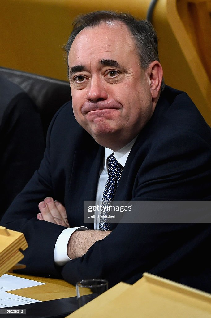 Alex Salmond takes a seat in the chamber as SNP leader Nicola Sturgeon is formally voted in as first minister of Scotland at the Scottish Parliament on November 19, 2014 in Edinburgh, Scotland. Ms Sturgeon who takes over from Alex Salmond will be the first woman to hold the post. On Thursday, she is due to swear an oath of allegiance before Scotland's judges at the Court of Session in Edinburgh, and will receive a Royal Warrant.