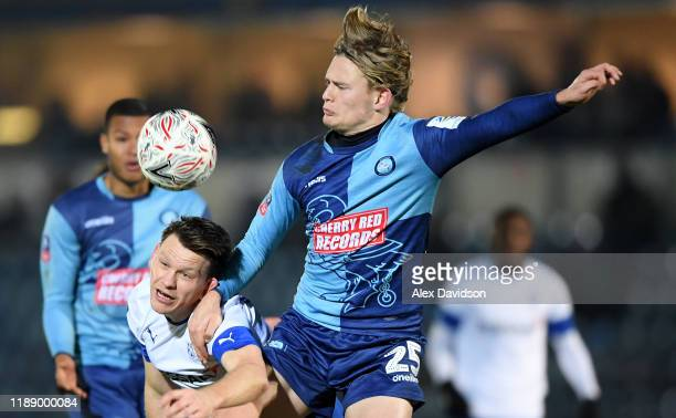 Alex Samuel of Wycombe Wanderers battles for possession with Sid Nelson of Tranmere Rovers during the FA Cup First Round Replay between Wycombe...
