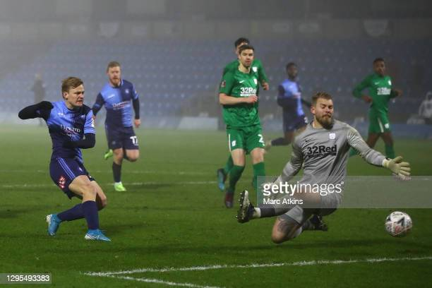 Alex Samuel of Wycombe Wanderers scores his team's fourth goal past Connor Ripley of Preston North End during the FA Cup Third Round match between...