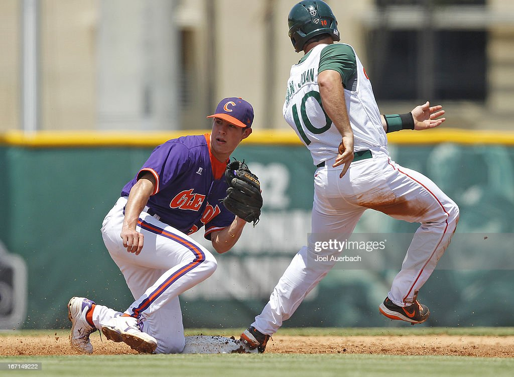 Alex San Juan #10 of the Miami Hurricanes steals second base ahead of the tag by Tyler Krieger #3 of the Clemson Tigers on April 21, 2013 at Alex Rodriguez Park at Mark Light Field in Coral Gables, Florida. Miami defeated Clemson 7-0.