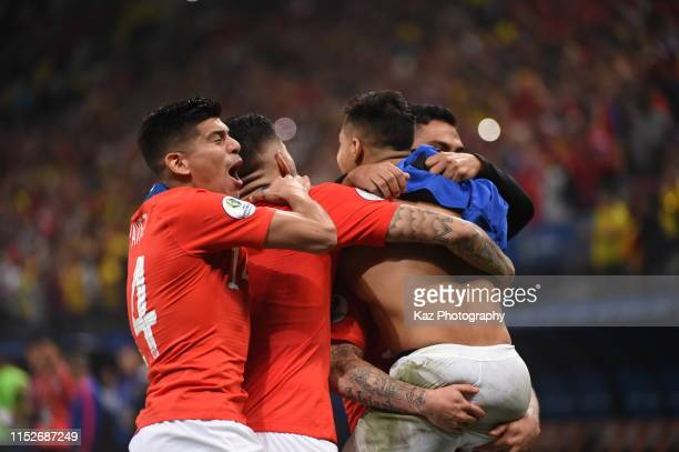 Alex Sanchez of Chile celebrates the victory with his teammates during the Copa America Brazil 2019 quarterfinal match between Colombia and Chile at...