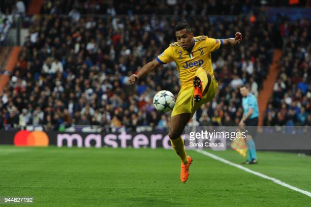 Alex Sandro #12 of Juventus in action during the UEFA Champions League Quarter Final Leg Two between Club Real Madrid and Juventus at Santiago...