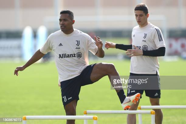 Alex Sandro and Alessandro Di Pardo of Juventus FC train during a Juventus FC training session at JTC on February 24, 2021 in Turin, Italy.