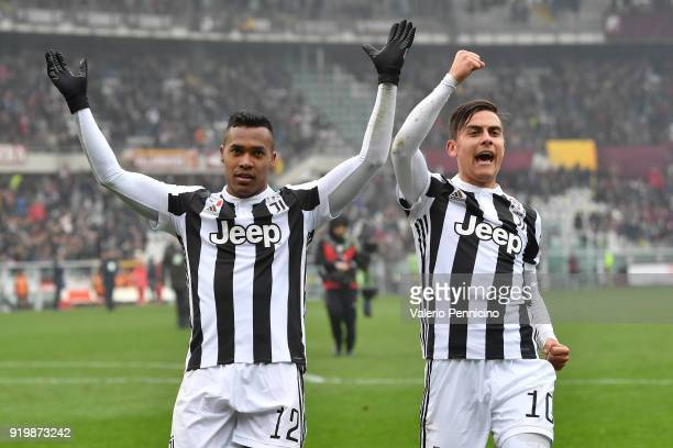 Alex Sandro and Paulo Dybala of Juventus celebrate victory at the end of the Serie A match between Torino FC and Juventus at Stadio Olimpico di...